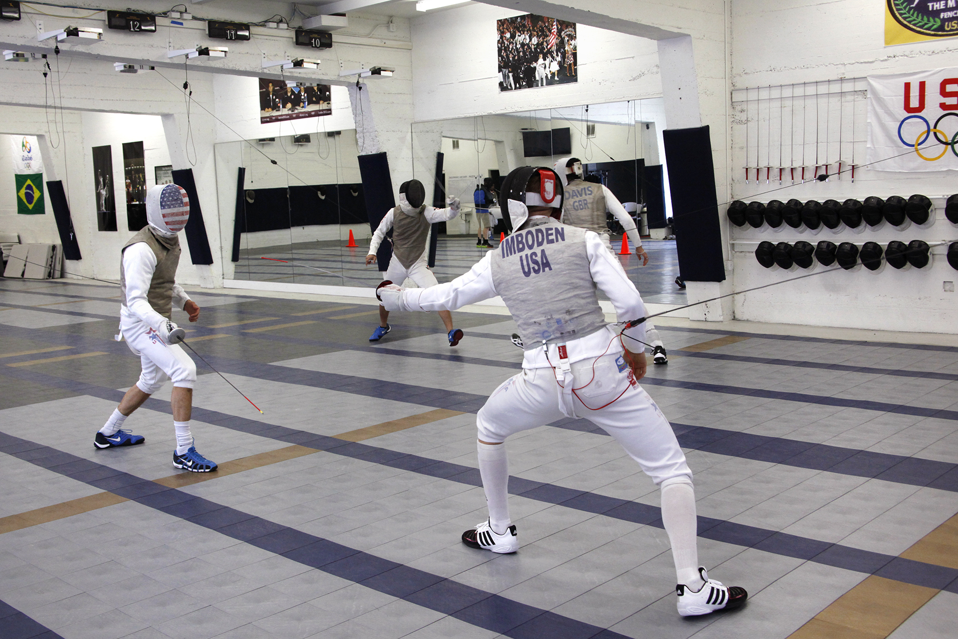 U.S. National fencing team athletes Gerek Meinhardt (left) and Race Imboden (right) practice their fencing techniques. Both will be heading to Rio to compete in the 2016 Olympics.