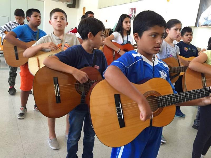 Mariachi summer campers practice a traditional Mexican ballad at Lawrence Cook Middle School in Santa Rosa.