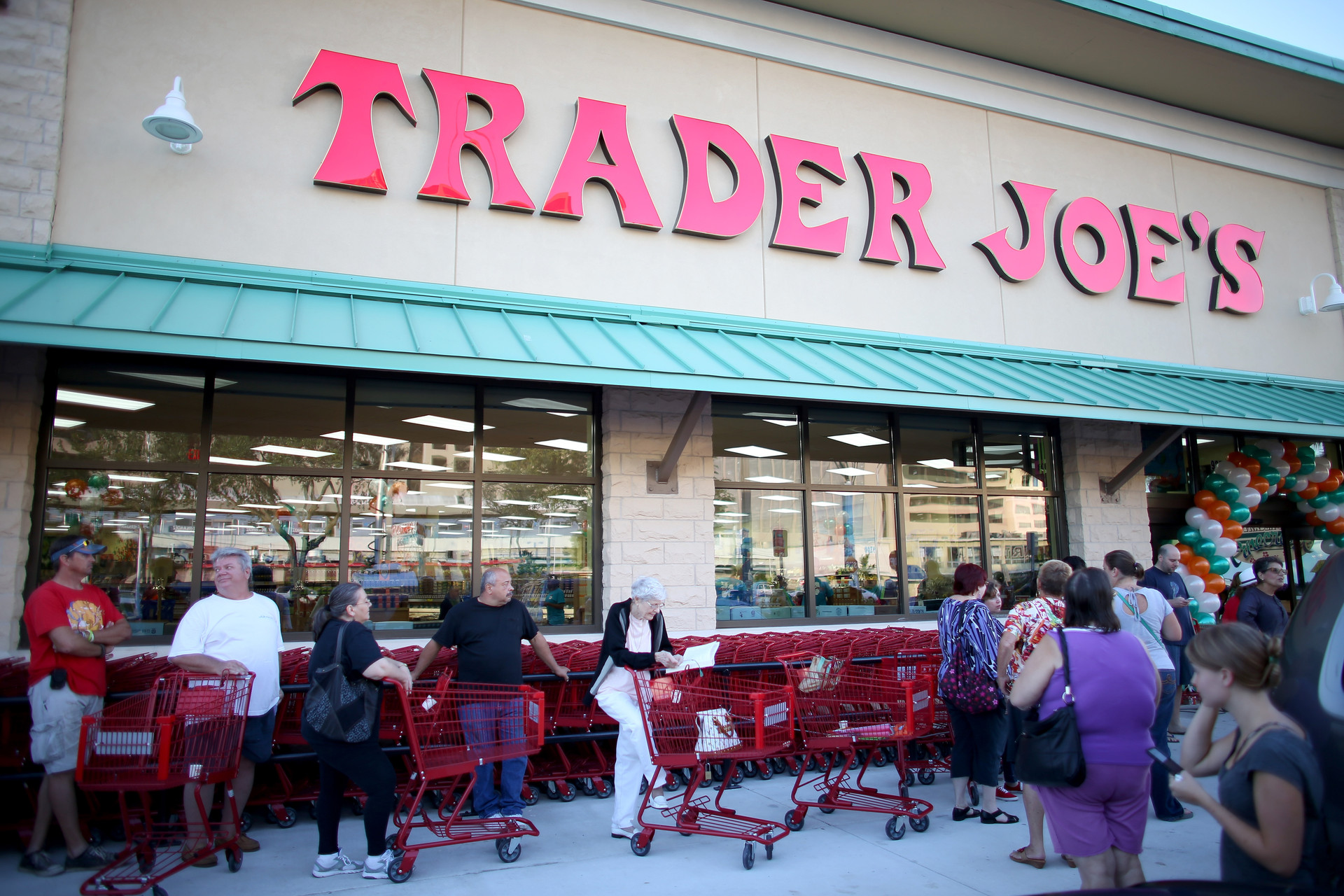 People shop at a Trader Joe's store.