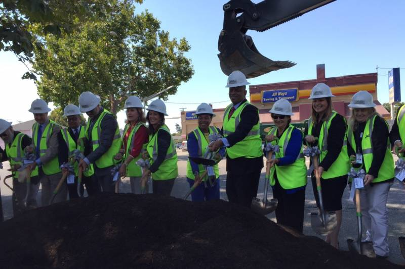 (Starting sixth from left to right) Oakland Mayor Libby Schaaf, U.S. Rep. Barbara Lee, U.S. Transportation Secretary Anthony Foxx and San Leandro Mayor Pauline Cutter ceremonially break ground on AC Transit's bus rapid transit line in Oakland on Aug. 26, 2016.