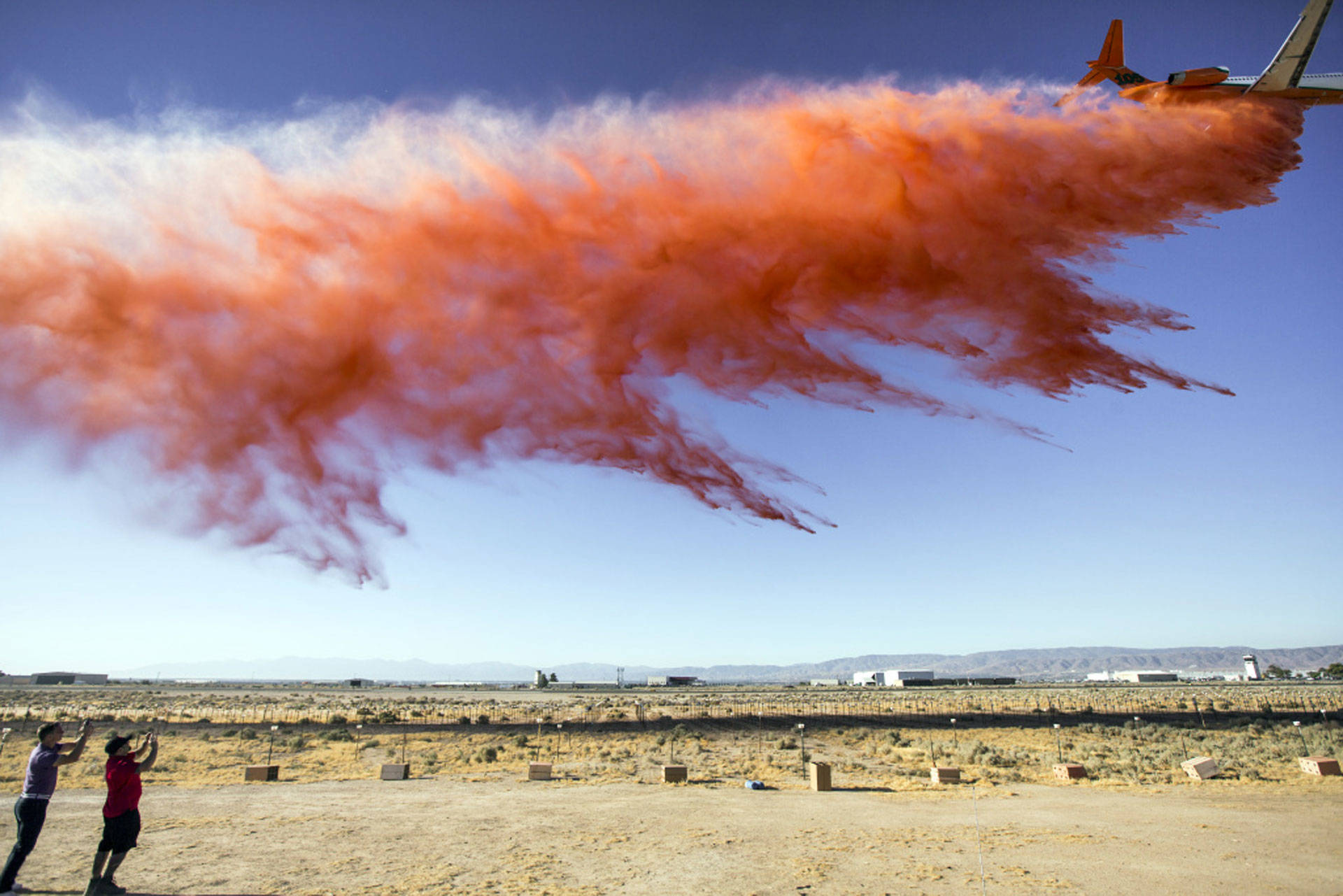 The U.S. Forest Service conducts a fire retardant drop test for a new air tanker at Fox Airfield in Lancaster on July 8, 2016. Maya Sugarman/KPCC