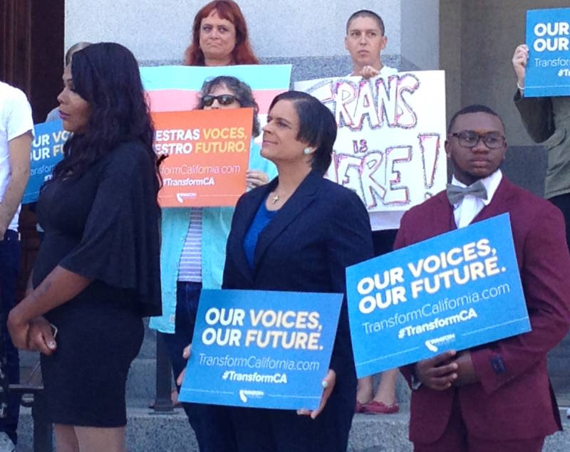 Leon Burse and other transgender advocates participate in a Transform California event outside the state Capitol.