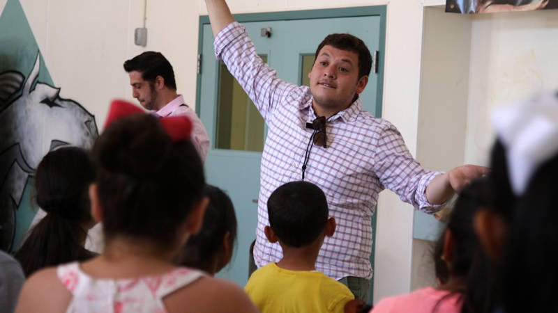 Mariachi summer camp's program director, Jose Soto, conducts about 50 campers during a recent practice.