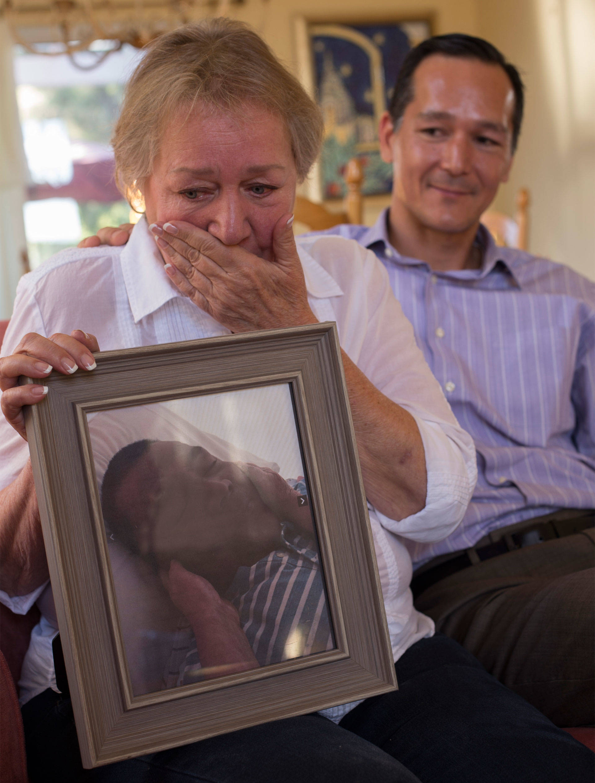 Rochelle Nishimoto  recounts the death of her son Jason with her other son Adrian. Lisa Pickoff-White/KQED