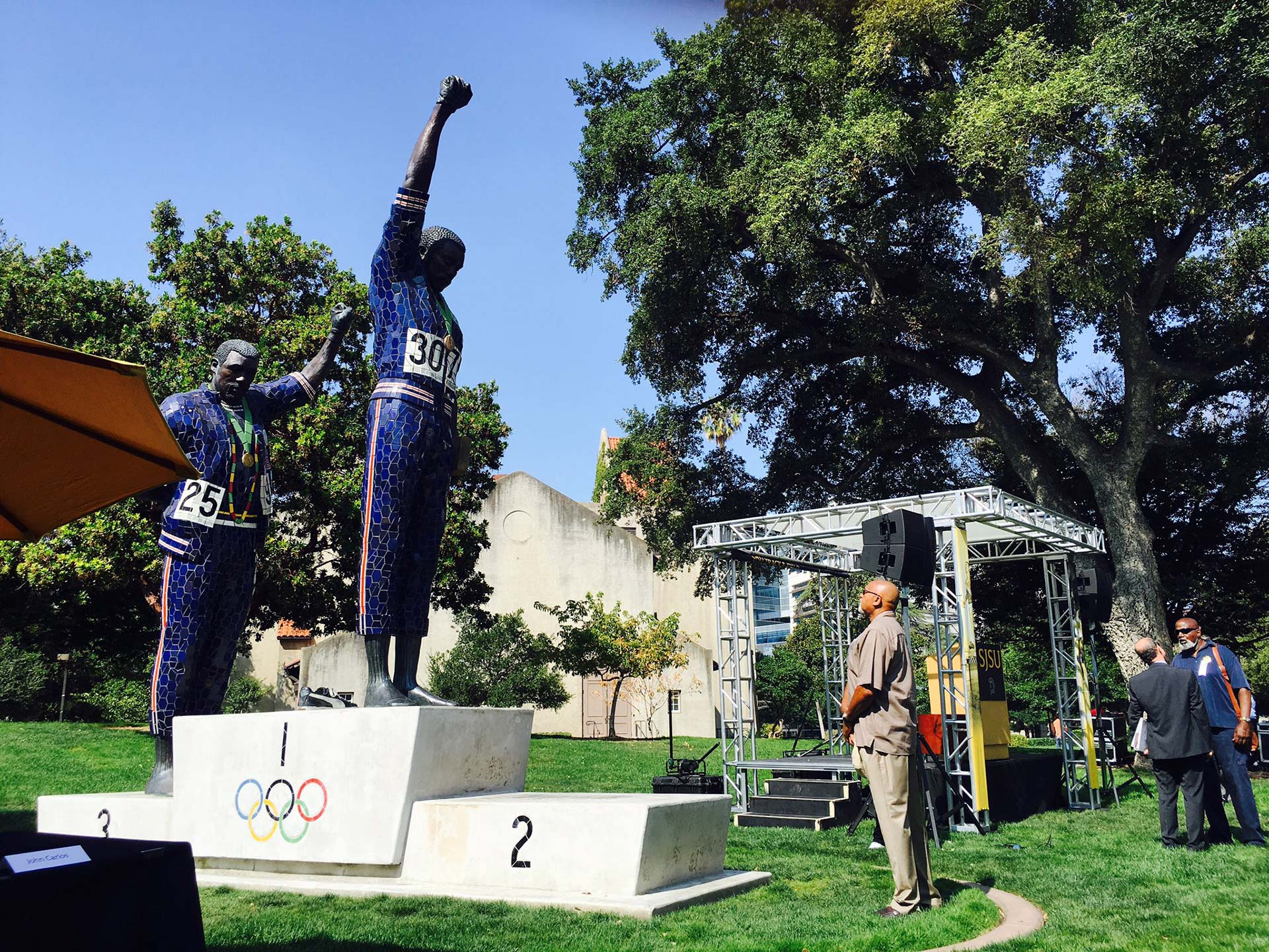 Tommie Smith looks at his statue at San Jose State on Aug. 1, 2016.
