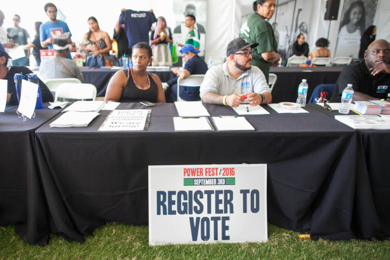 Local residents learn about the history of African-American voting in the U.S., issues that will be on the ballot and how they can register to vote during the 5th Annual Power Fest Music and Art Festival in Martin Luther King Jr. Park on Saturday, Sept. 3, 2016.