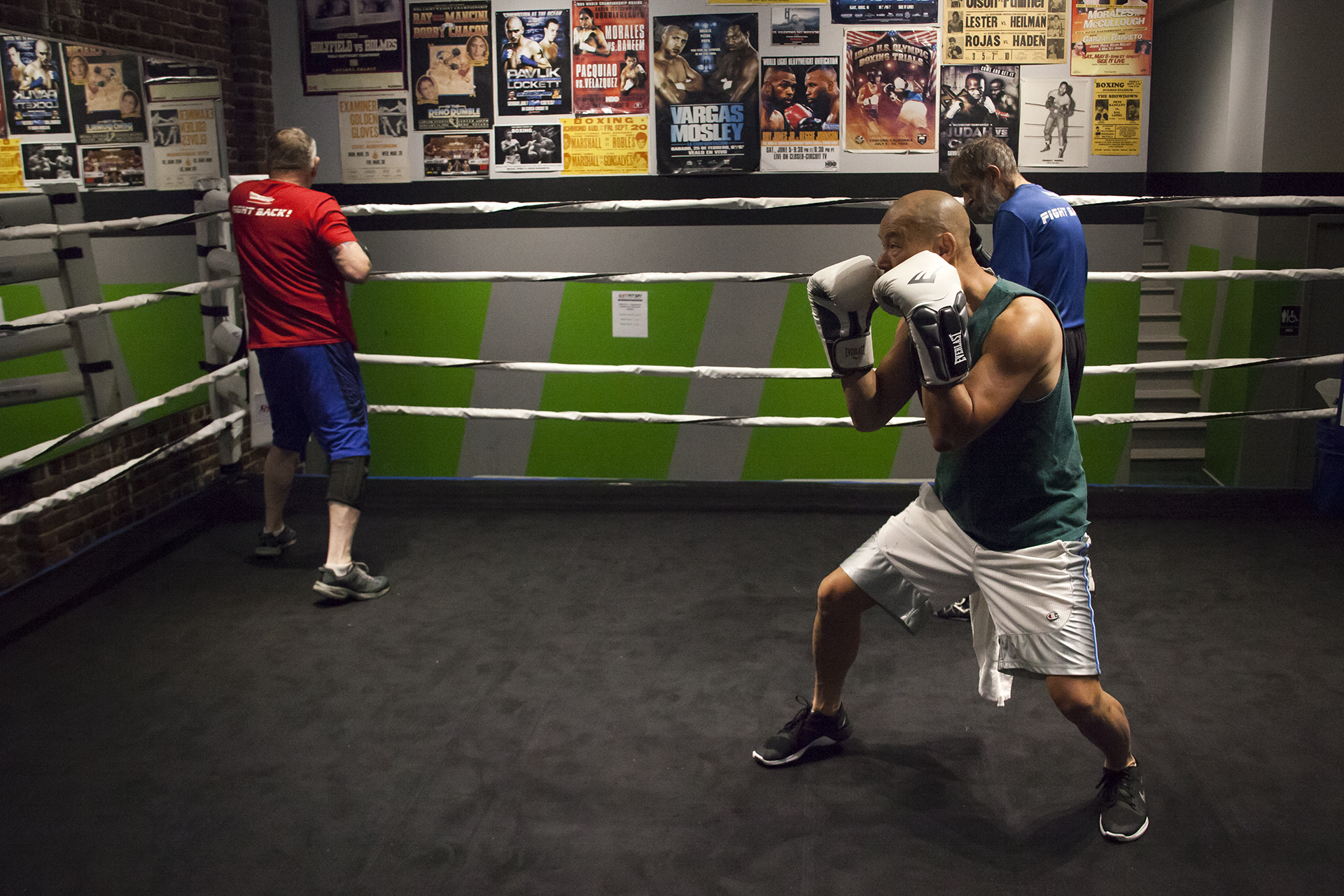 Kevin Kwok (center) practices shadow boxing during a Rock Steady Boxing class at HitFit SF in San Francisco, California.