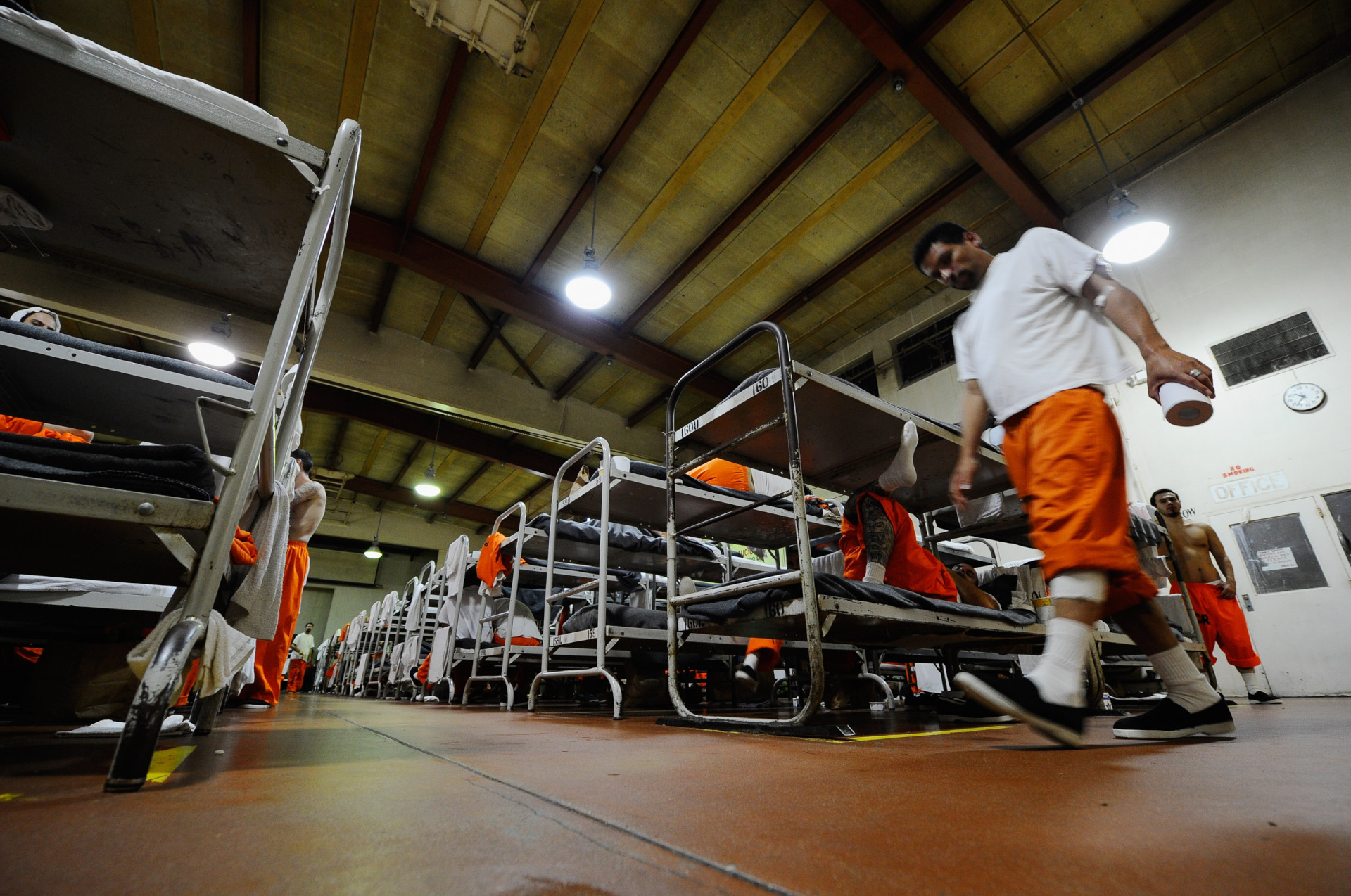 An inmate at the Chino California Institution for Men State Prison sleeps on his bunk bed in a gymnasium that was modified to house prisoners on December 10, 2010 in Chino, California.