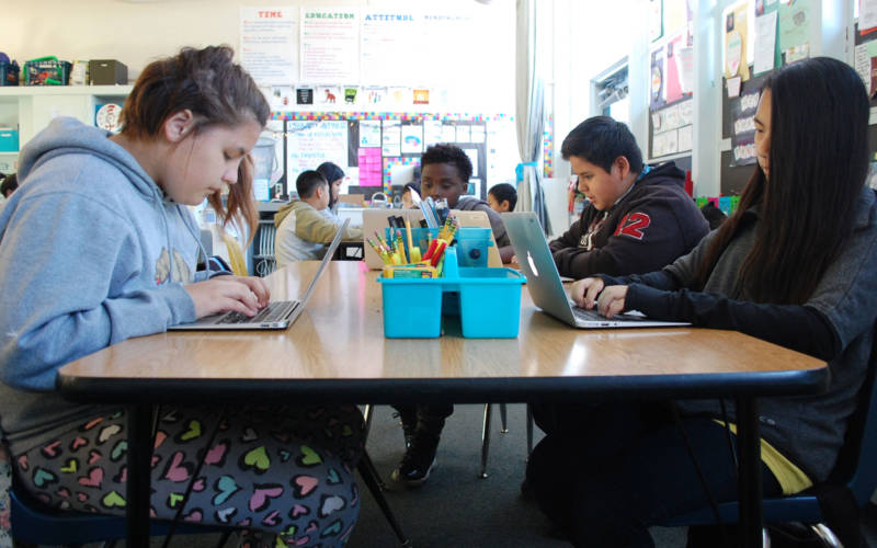 A class of sixth grade students tackle a computer assignment at Oak Ridge Elementary in Sacramento.