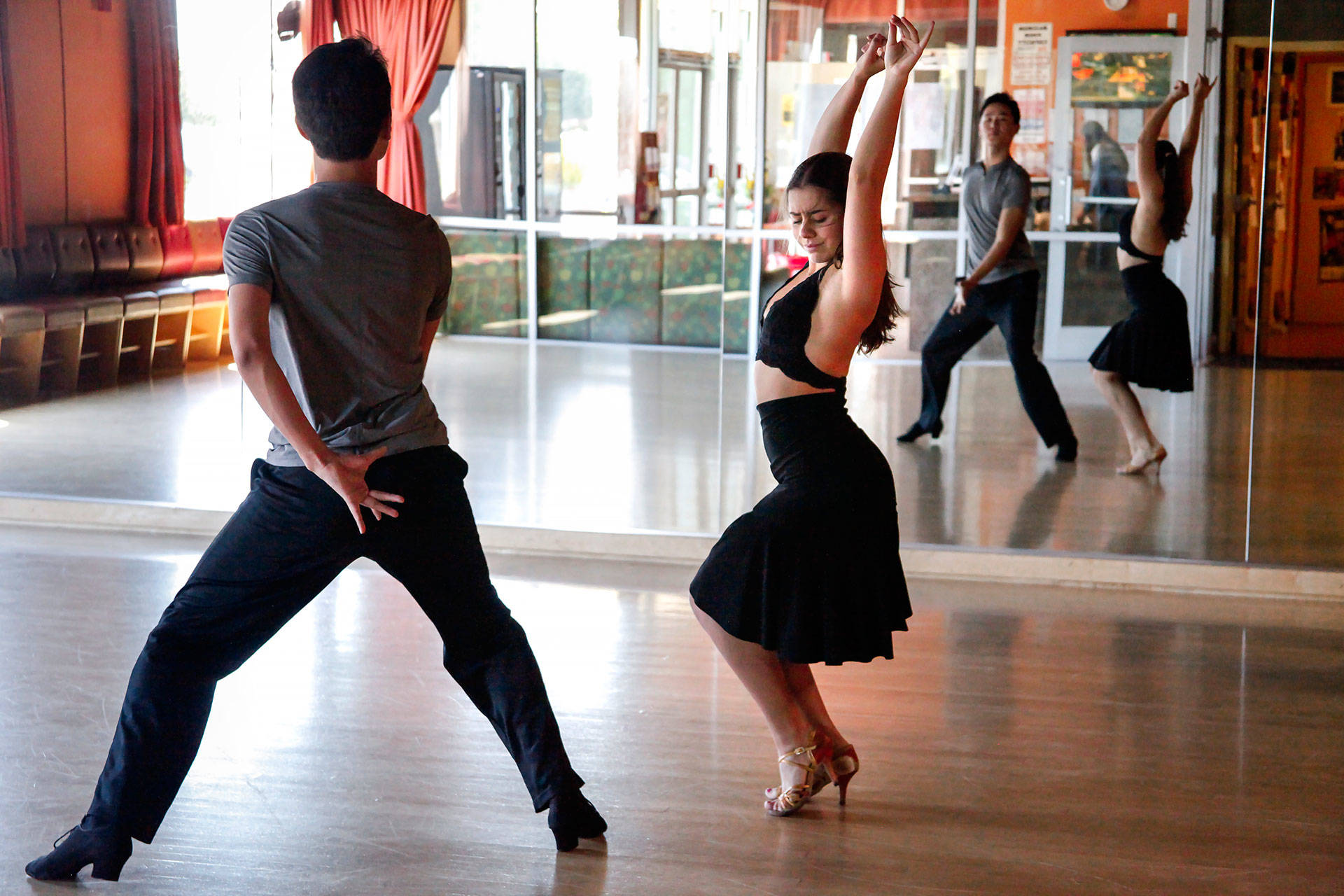 Bumchin Tegshjargal started dancing with his partner. Michelle Klets, a year and a half ago. In that short time, they've become one of the country's top young couples in Latin dance.  Brittany Hosea-Small/KQED