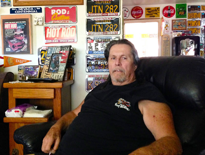 Dave Ellis, Summit Inn regular for almost 20 years, at home with his massive automotive memorabilia collection.