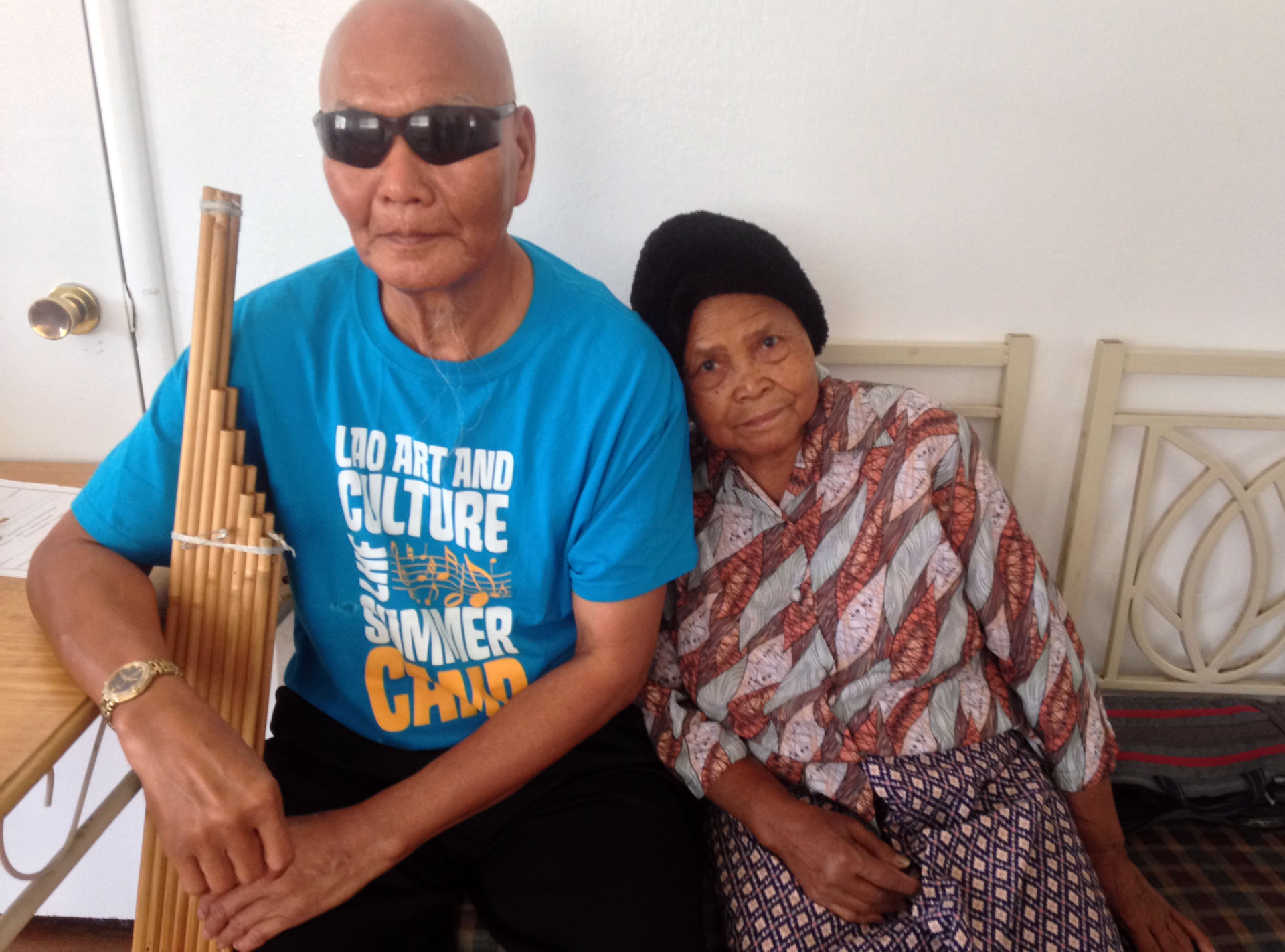 Bounxeung Synanonh (L) is a master of the khaen, a traditional Laotian bamboo mouth organ. He met his wife Kham Souvanakhyly (R) in Fresno. She says she doesn't care if Synanonh can't see her because she knows he loves her.