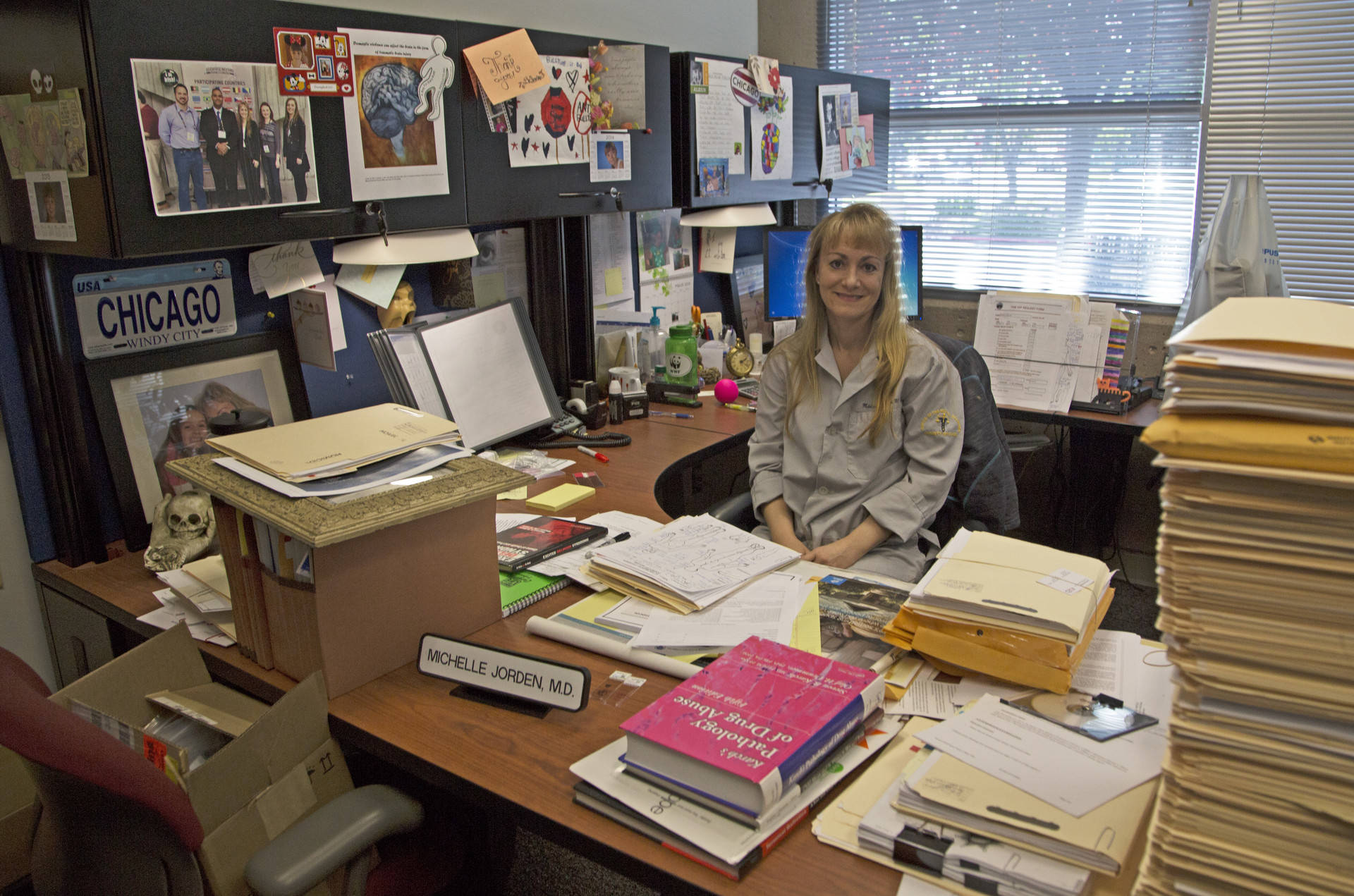 Reports are stacked high on the desk of Assistant Medical Examiner Michelle Jorden. The medical examiner¹s office in Santa Clara County handles more than 4,000 cases a year. Lisa Pickoff-White/KQED