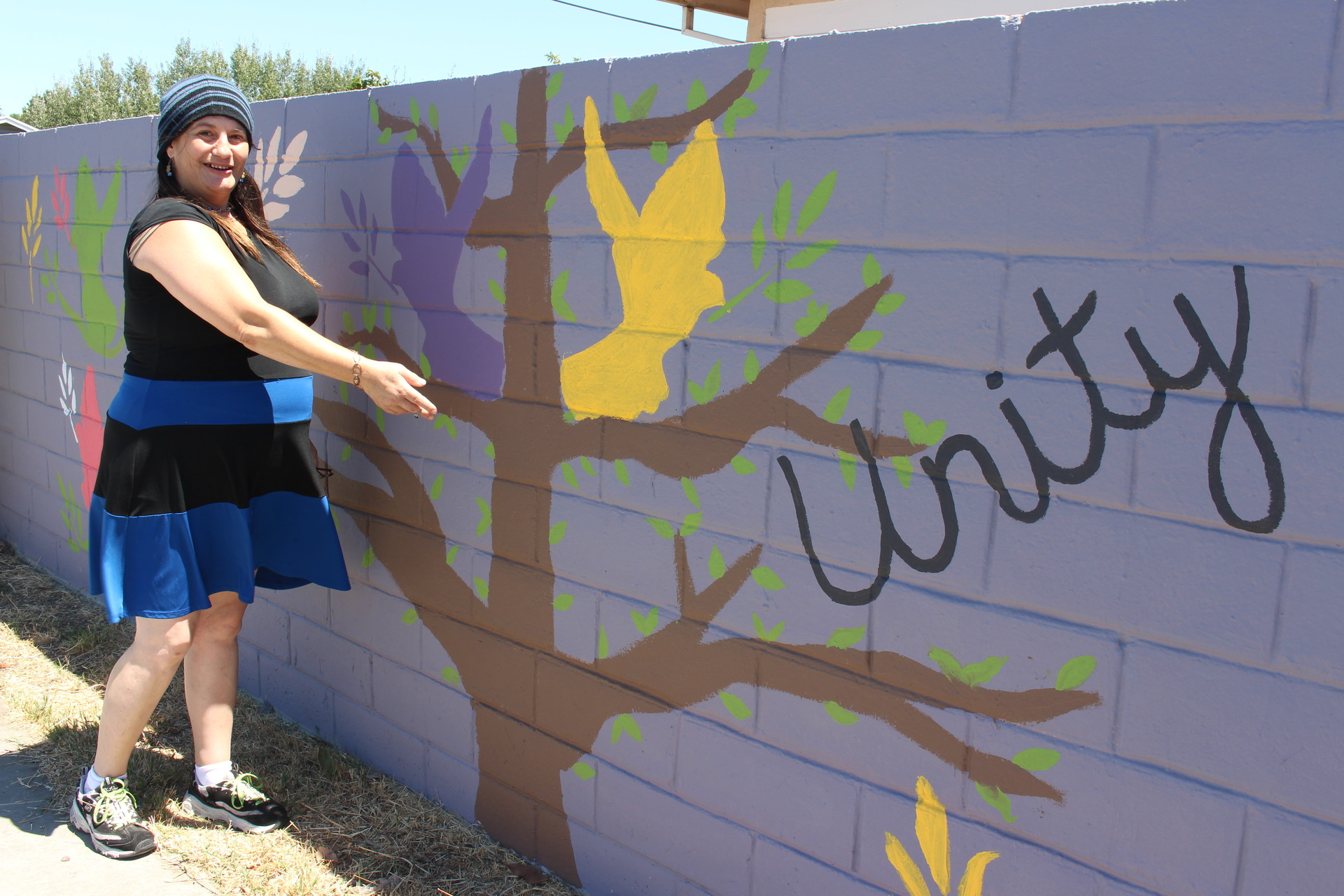 Melonie Willis at the mural she helped paint with Sheriff's employees and neighbors on Moorland Avenue, on July 29, 2016.