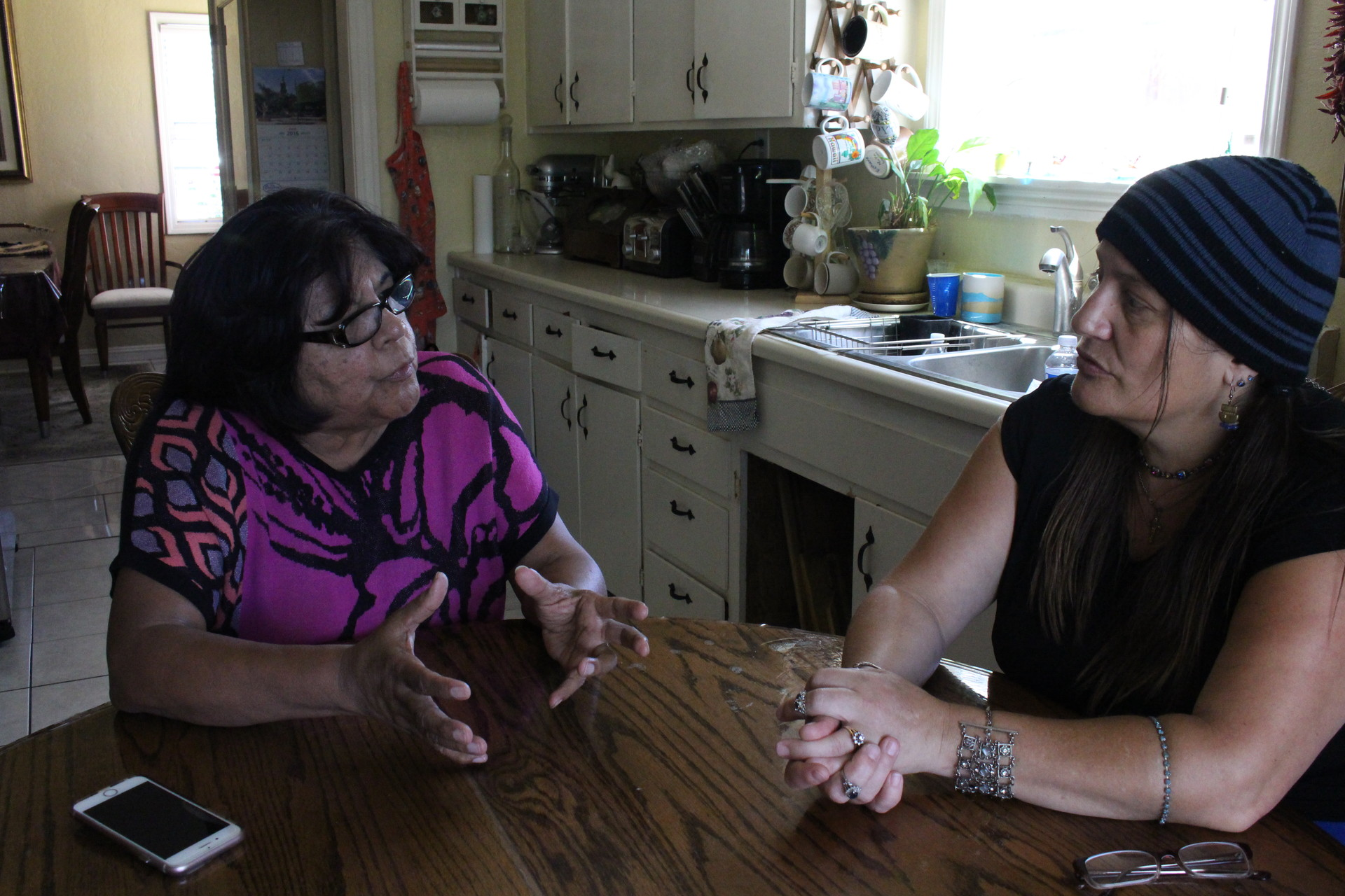 Esther Lemus and Melonie Willis at Lemus' home in the Moorland neighborhood on July 29, 2016. Willis and Lemus pushed for more street lights and invited the Sheriff's Department to paint a community mural.