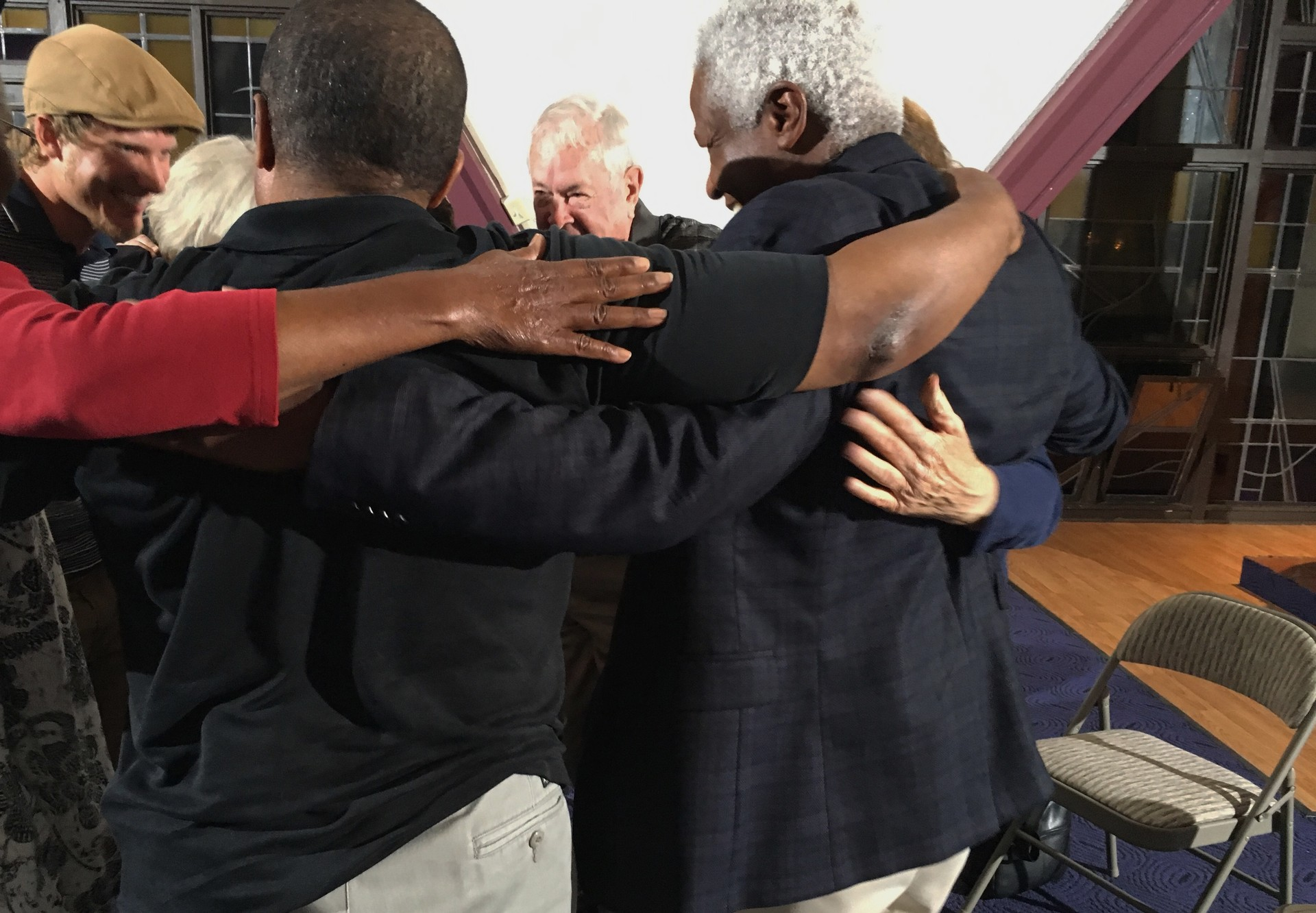 Racists Anonymous members hug after a meeting at a chapel in Sunnyvale. The diverse group includes a psychiatrist, preschool director, landscaper, and retired business executive.