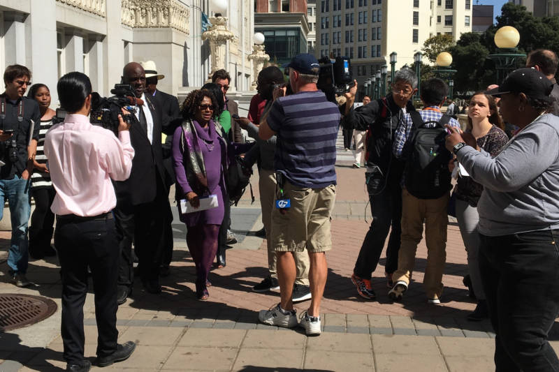 Jasmine Abuslin's attorney Pamela Price is flanked by reporters as she leaves an Oakland press conference on Sept. 15, 2016.