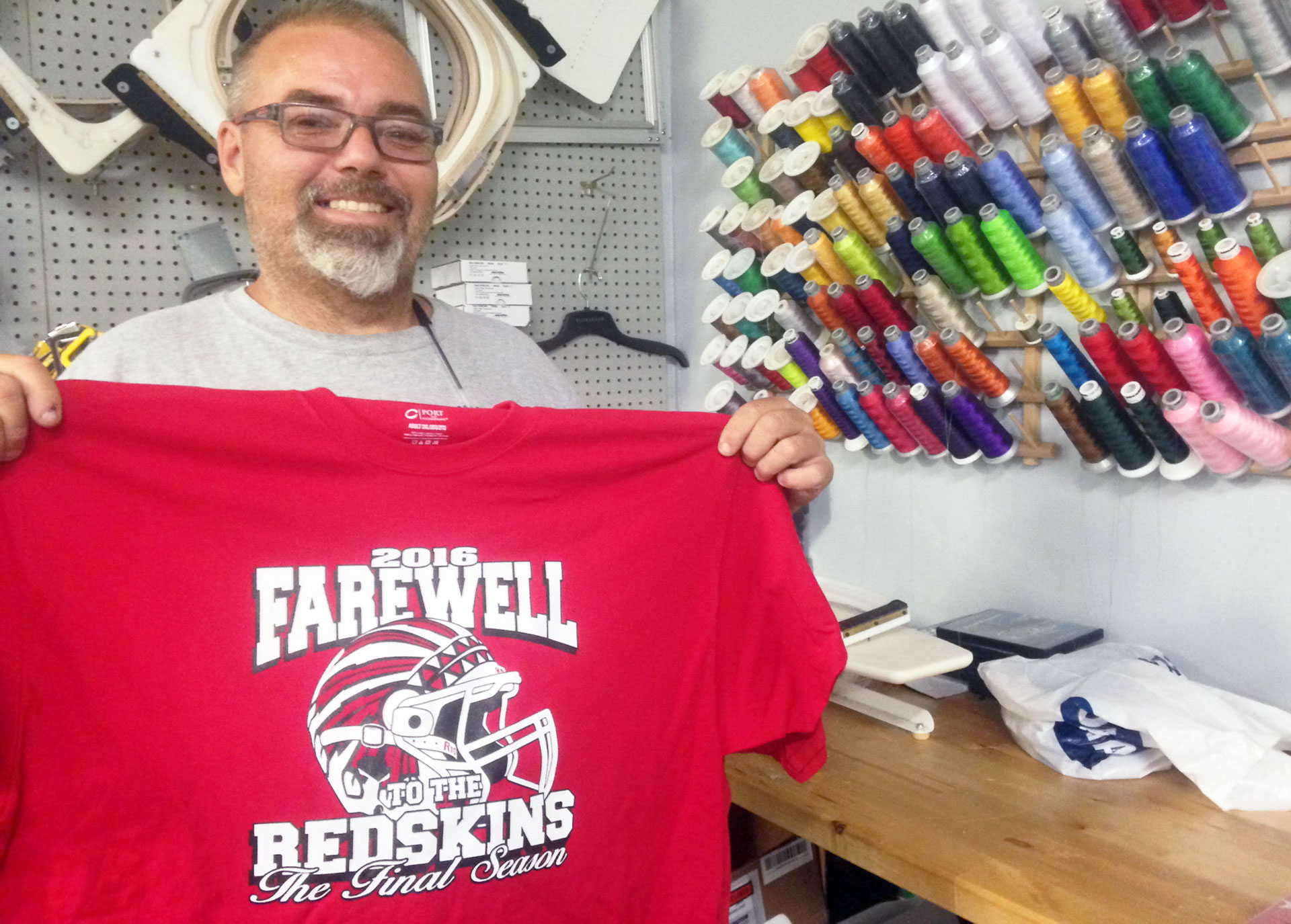 "Chowchilla resident Ron Thomas, who is one-eighth Native American, holds one of the limited edition Redskins ""final season"" T-shirts he's made."