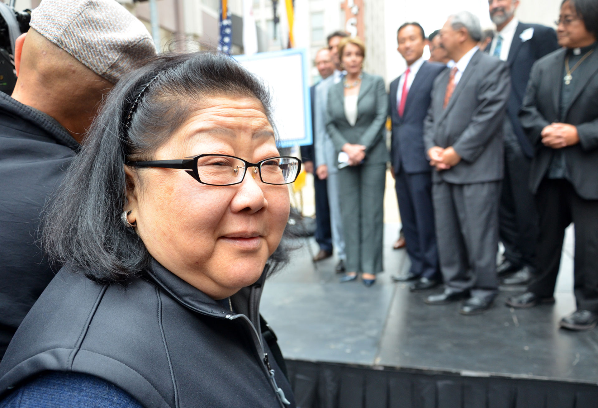 "Rose Pak attends a Central Subway event in San Francisco in 2012. Ed Lee, about whose mayoralty Pak said she was ""heartbroken,"" stands in the background."