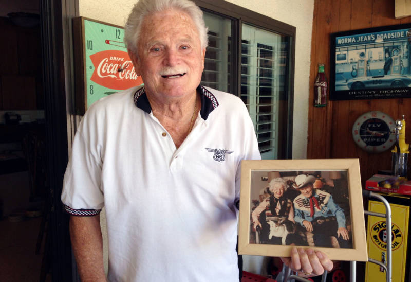 Cecil Stevens holds a photo of neighbors Roy Rogers and Dale Evans.