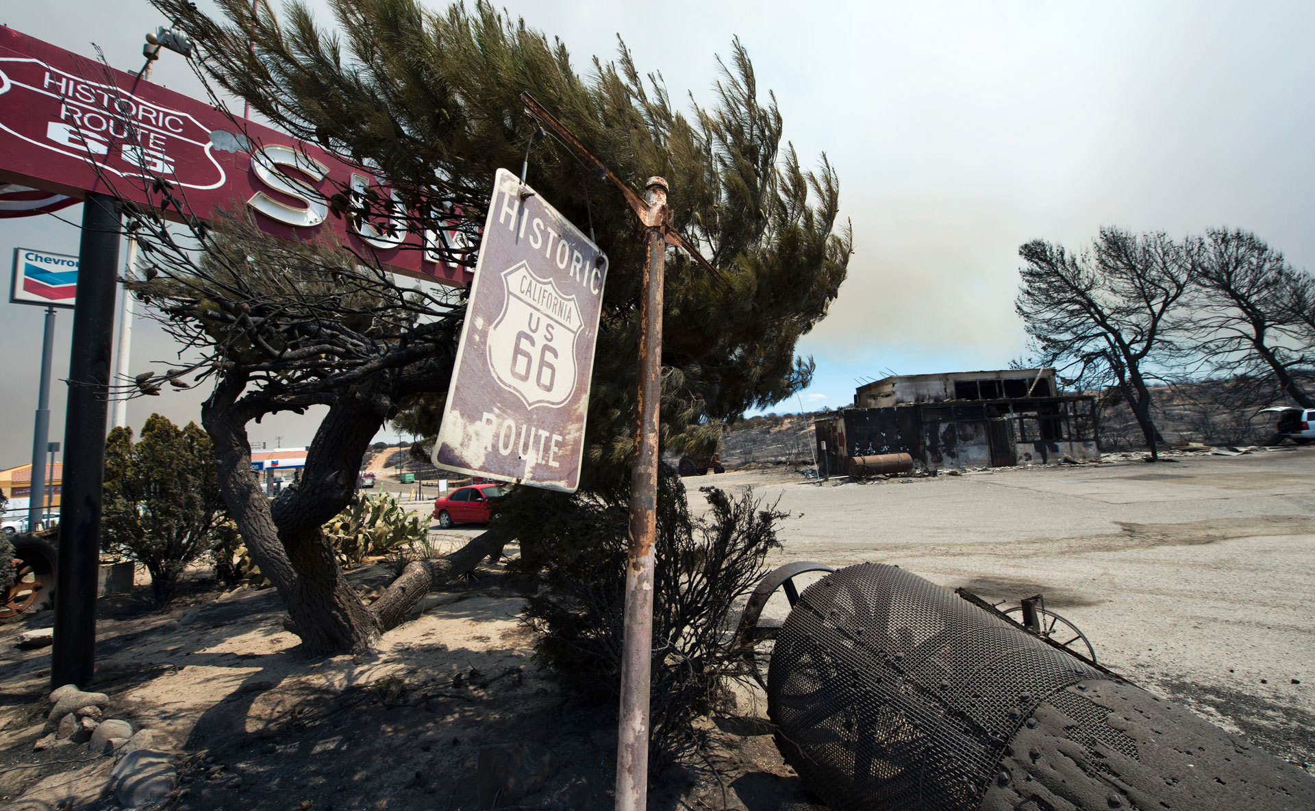 A Route 66 sign is one of the only things still standing after the Blue Cut Fire burned the historic Summit Inn diner to the ground.