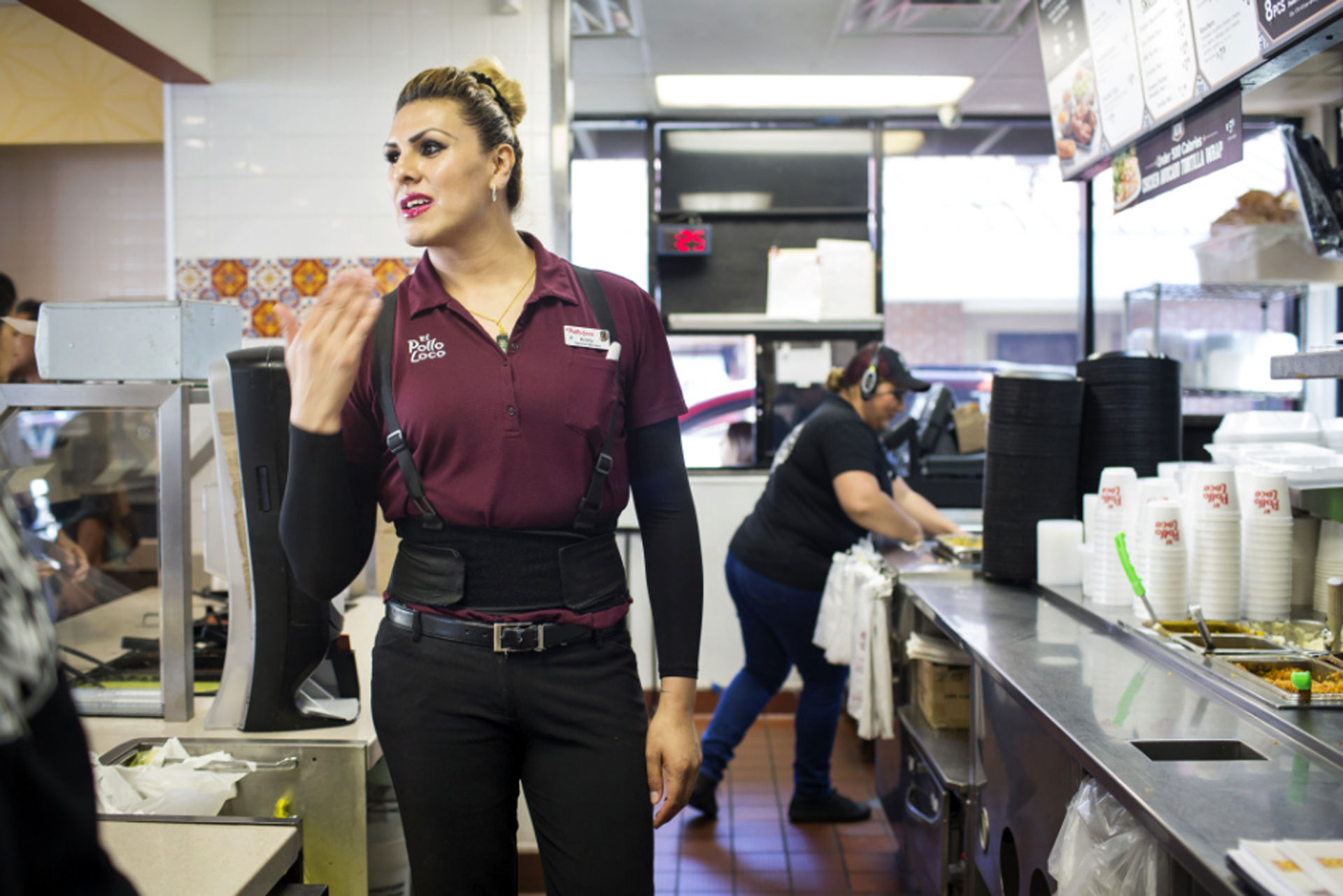 General Manager Kristy Ramirez helps a customer order at one of Michaela Mendelsohn's six El Pollo Loco franchises she owns in Southern California on July 14, 2016.