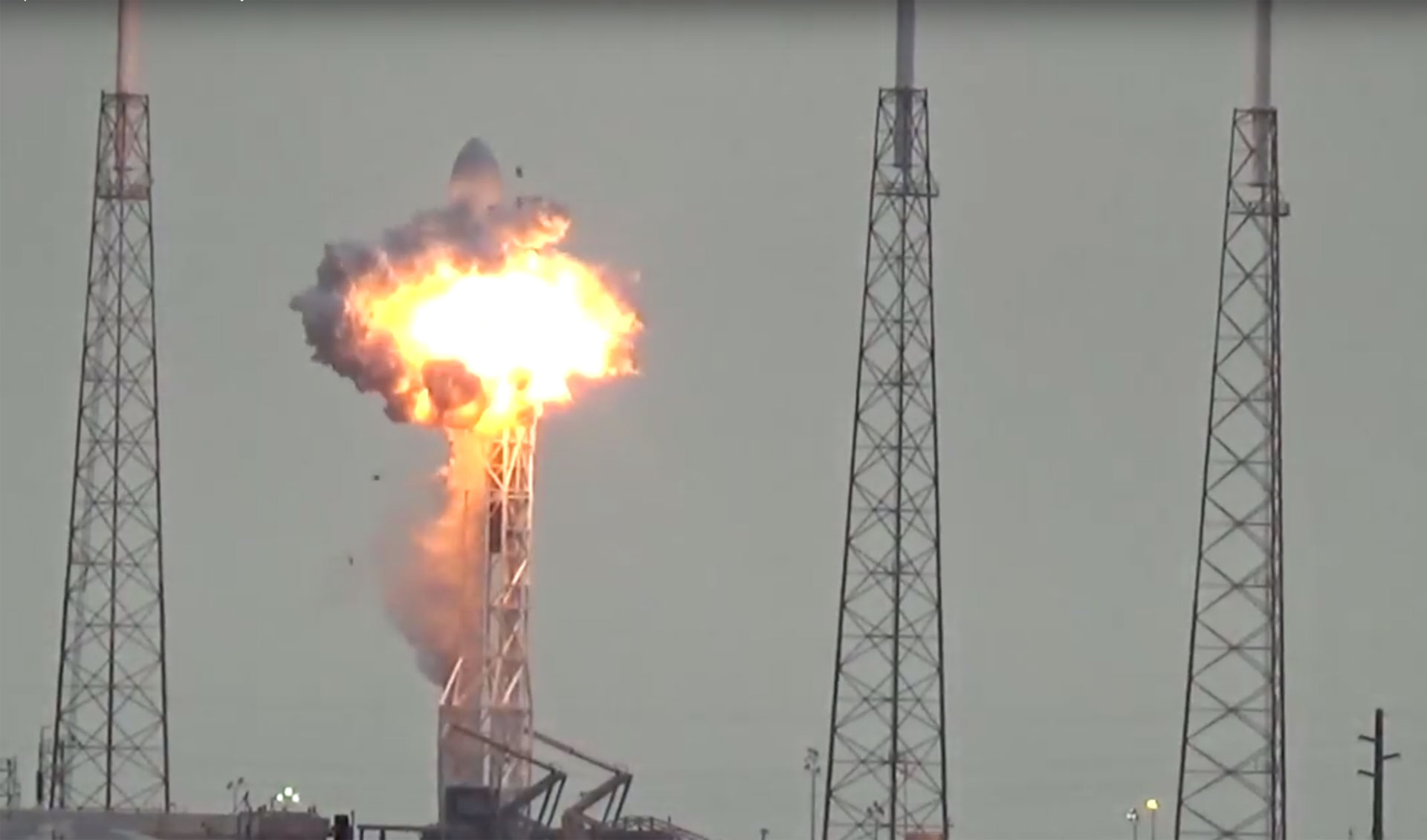 An unmanned SpaceX Falcon rocket explodes on the launchpad Thursday morning.