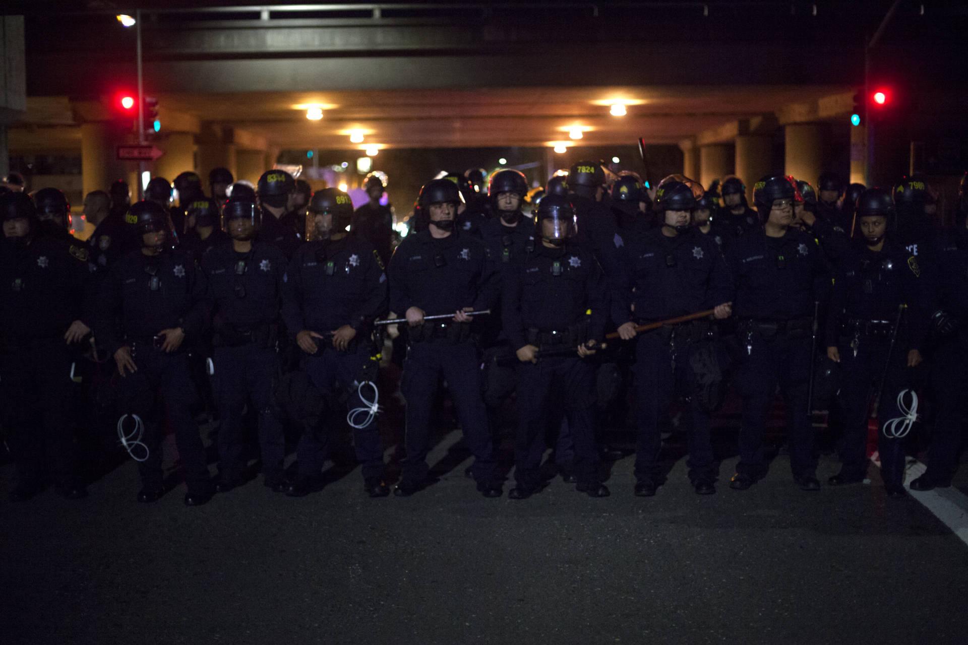 Police under a freeway.