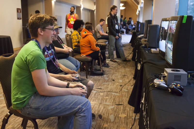 Jennifer Unkle (left) and Colin Dettmar play Mario Kart Double Dash in the Magfest Arcade at the GX4 convention.