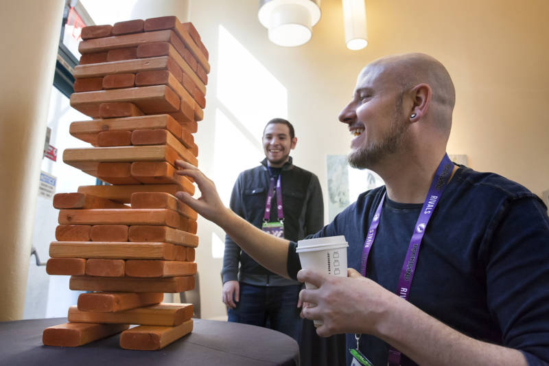 Greg Gadwood (right) plays a game of Giant Jenga with Alex Meza at the GaymerX GX4 Convention.