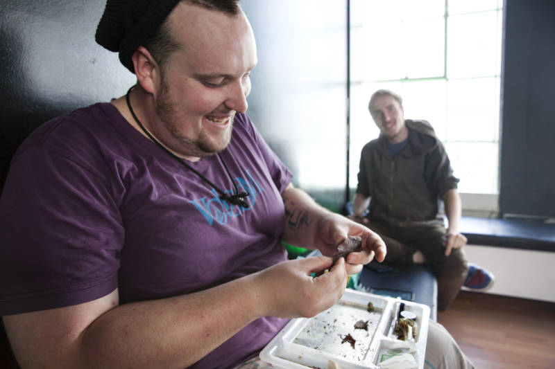 Nic Ash rolls a 'Backwoods' in the smoking lounge upstairs from the shop. Green Door is one of only a few dispensaries in San Francisco that offers a lounge where patients can use their product after purchasing it.