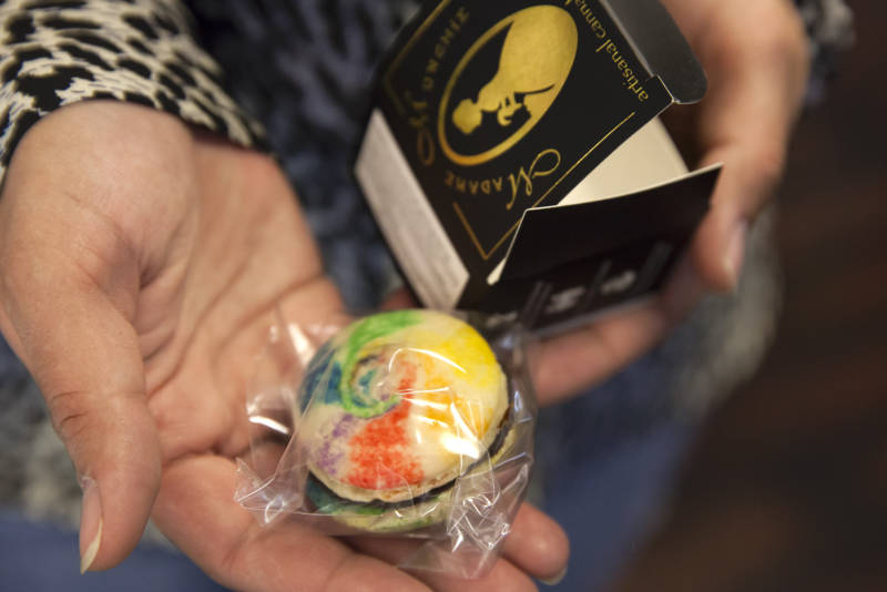 A staff member at the Green Door dispensary in San Francisco, California holds a cannabis-infused macaroon by Madame Munchie.