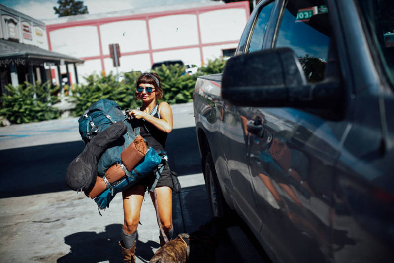 Emily Rothman of Florida throws her pack into a truck that will take her to a friend's pot farm in Garberville. She said all the women she knows have been warned of things to watch out for when coming to the area for work.