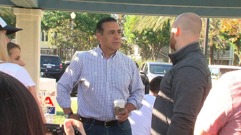 U.S. Rep. Darrell Issa reaches out to volunteers while campaigning in Orange County, Oct. 1, 2016.