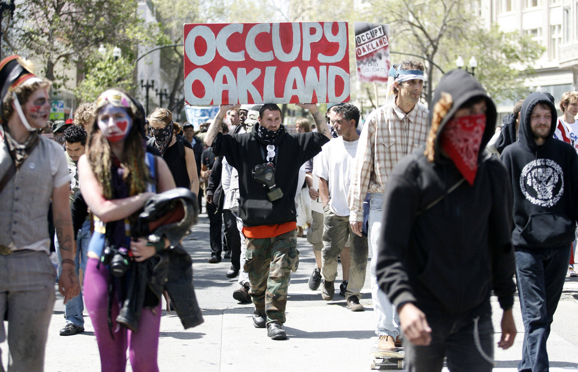 Occupy Oakland protesters march near City Hall in downtown Oakland during a May Day protest on May 1, 2012.  KIMIHIRO HOSHINO/AFP/GettyImages