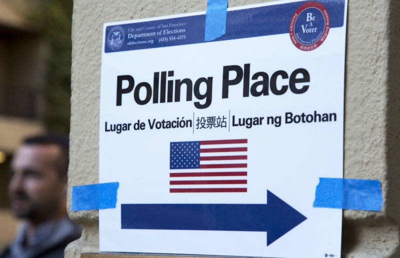 A sign points the way to a San Francisco polling place.
