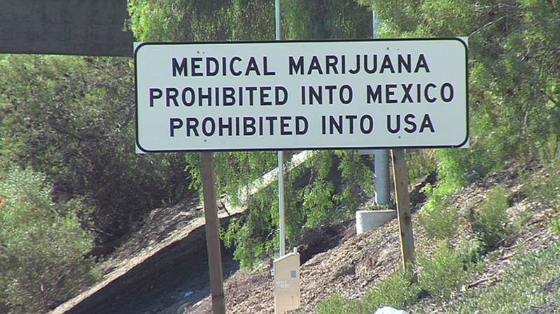 A sign on the southbound Interstate 5 warns against smuggling marijuana into Mexico or the United States.