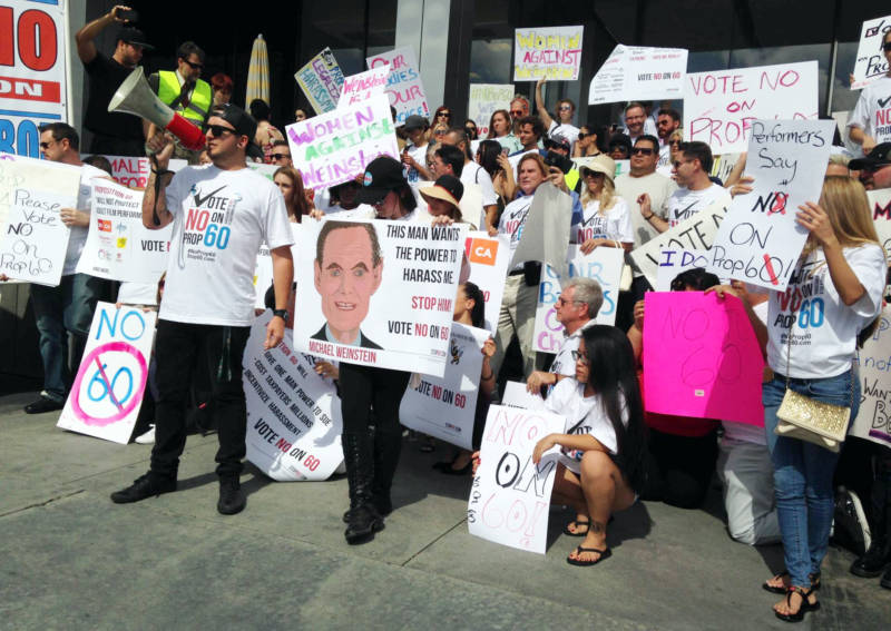 Adult film performers rally against Proposition 60 outside Michael Weinstein's office.