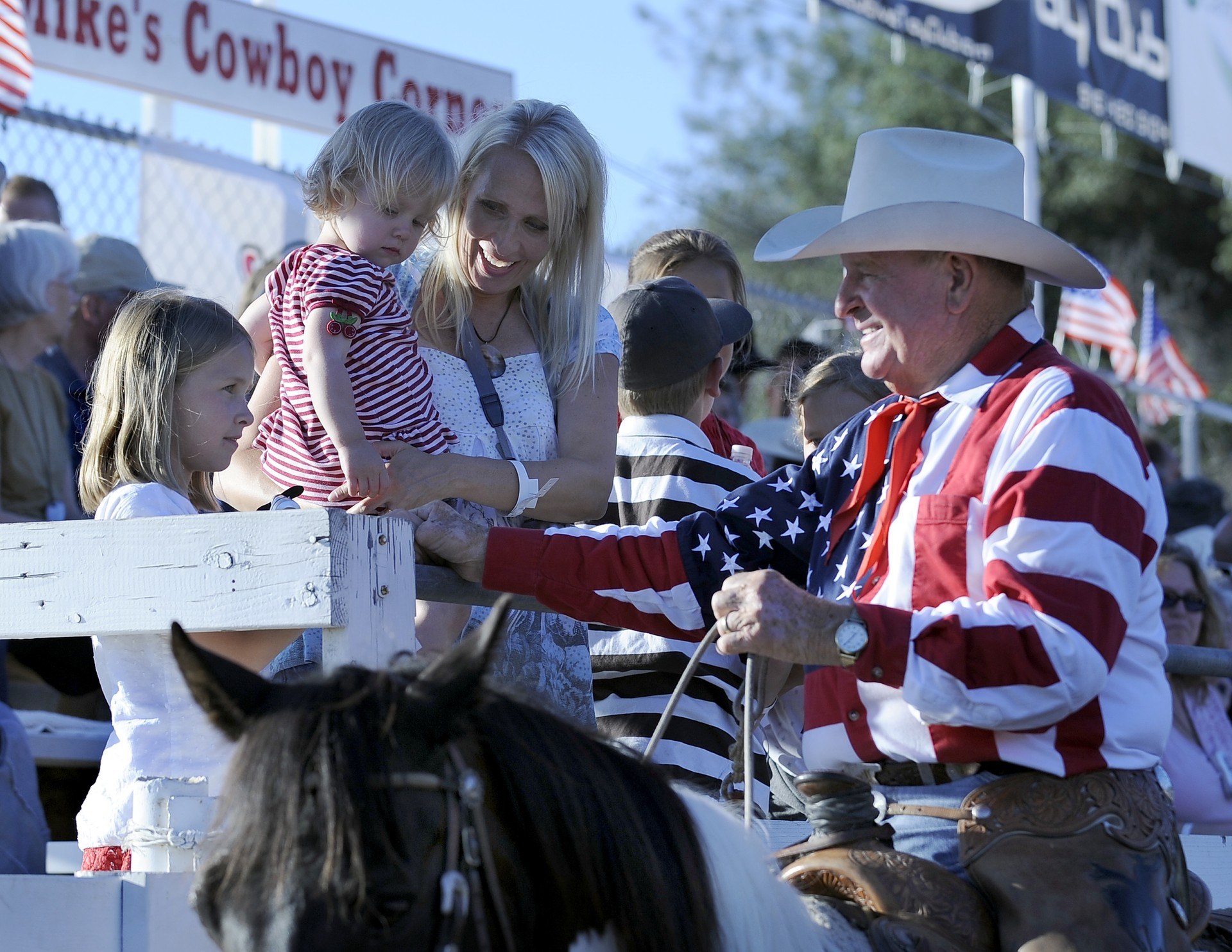 Cotton Rosser greets children in the stands at the Folsom Pro Rodeo in Folsom, CA.