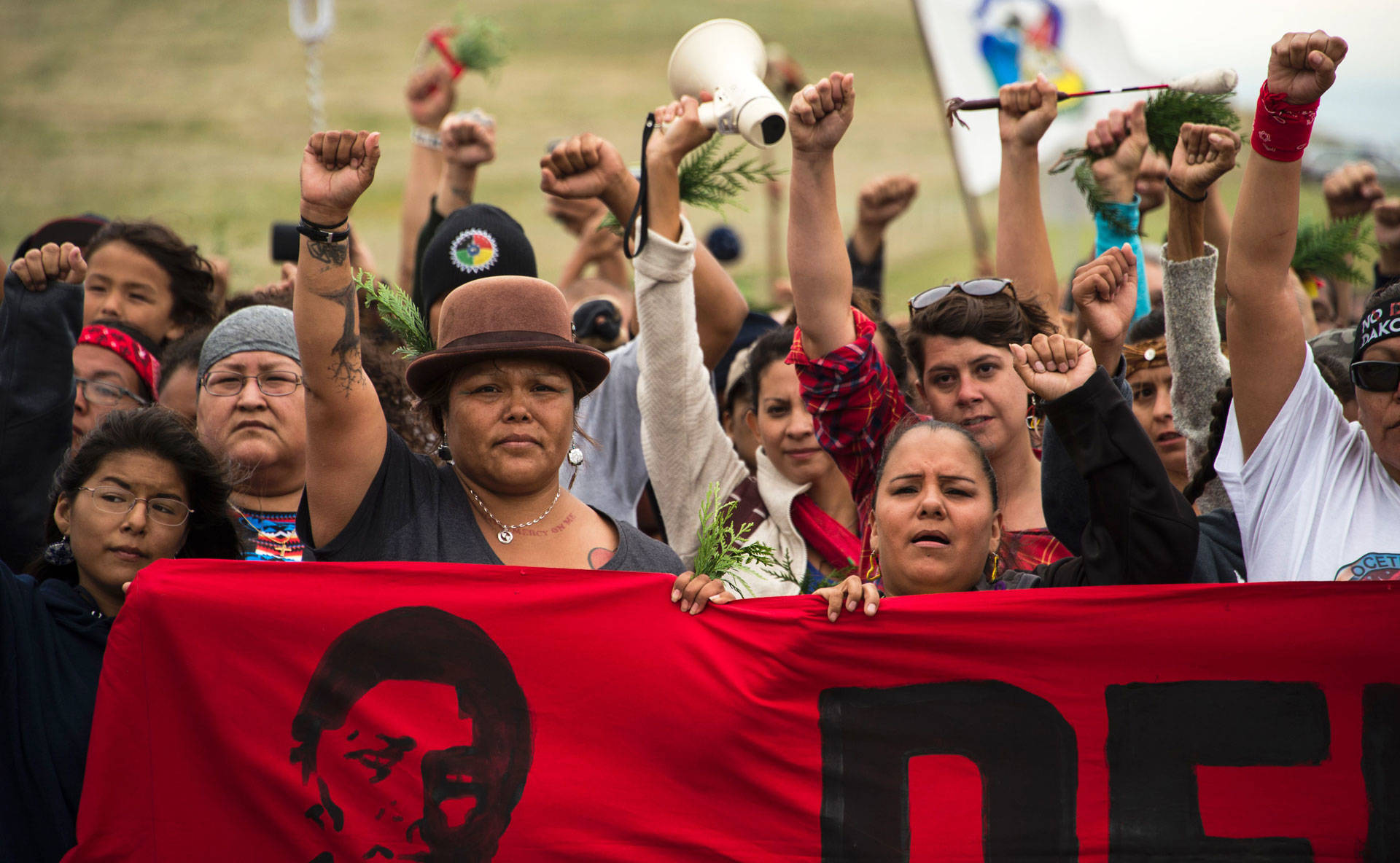Native Americans march to a sacred burial ground site that was disturbed by bulldozers building the Dakota Access Pipeline, near the encampment where hundreds of people gathered to join the Standing Rock Sioux Tribe's protest of the oil pipeline that was slated to cross the Missouri River on Sept. 4, 2016. Robyn Beck/AFP/Getty Images