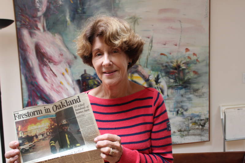 Margaret Schaefer holds a news clipping saved from the day after the East Bay Hills Fire.