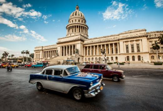 Cuba's capitol building in the heart of Old Havana. Though the country's infrastructure and cars are stuck in the 1950s, its healthcare system is remarkably innovative.