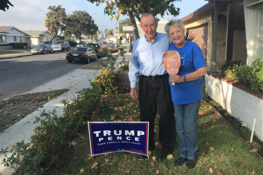 Bill and Shirley Thomas outside their home in Long Beach. Their Trump signs were stolen three times before the election, they say, but this latest sign has lasted about five weeks.