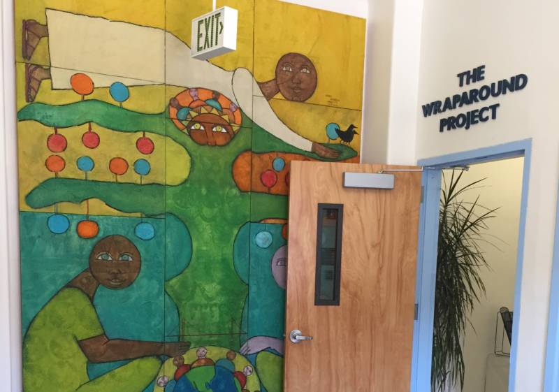 A mural, painted by the father of a former client, marks the entrance to The Wraparound Project at Zuckerberg San Francisco General Hospital and Trauma Center.