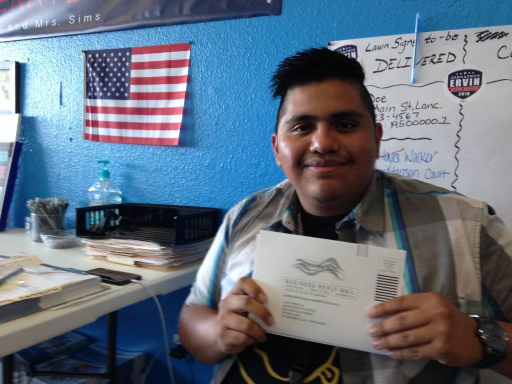 Chris Martinez, 20, holding his completed voter registration form.