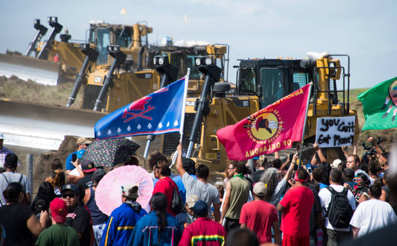 Members of the Standing Rock Sioux Tribe and their supporters opposed to the Dakota Access Pipeline (DAPL) confront bulldozers working on the new oil pipeline near Cannon Ball, North Dakota. Donald Trump has surrounded himself with climate change deniers, oil industry executives and lawmakers from states like North Dakota who are eager to expedite production of oil, gas and coal.