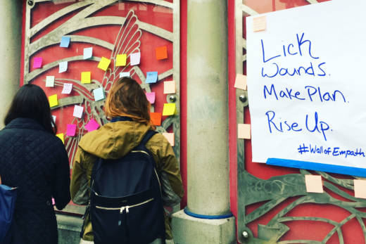People write messages of support following Donald Trump's election victory on the walls at the 16th St. BART station in San Francisco on Monday, Nov. 14.