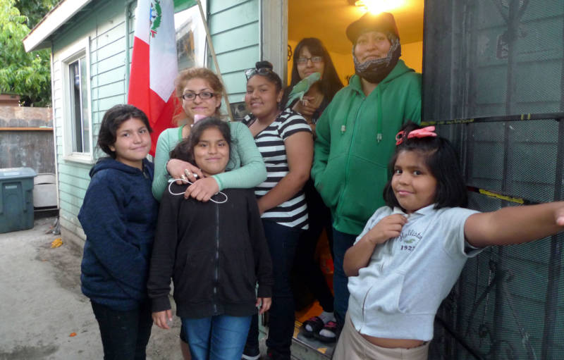 Rocio Tafoya (in green) with some of her children at the East Salinas apartment they rent.