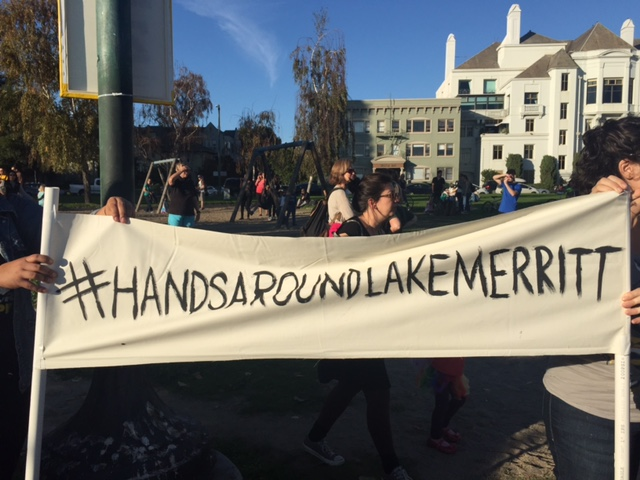 People gathered on Saturday, Nov. 12, to hold hands around Lake Merritt in Oakland to protest the election of Donald Trump as president.
