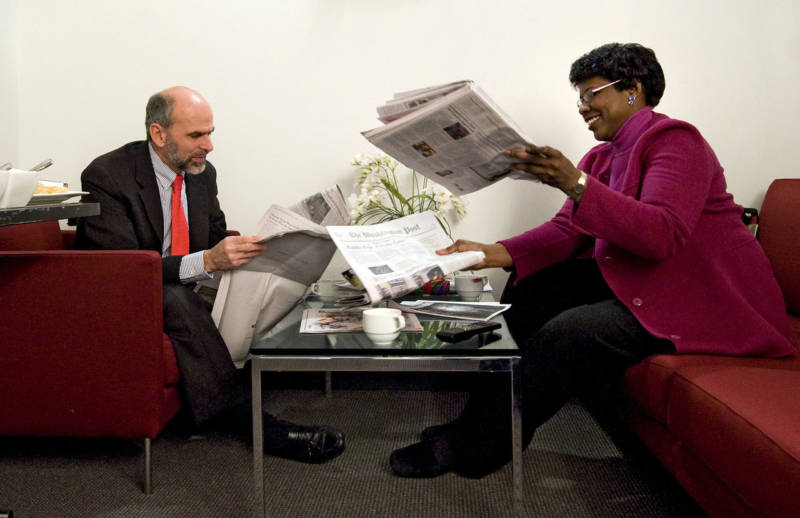Gerald Seib (L) and Gwen Ifill go over the news before filming ABC's This Week at the Newseum in Washington, D.C., in December 2008.